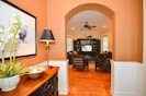Entryway opens up to reveal the spacious open concept living, dining & kitchen