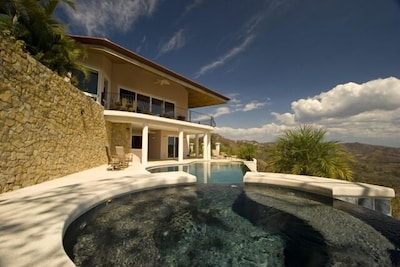 Back view of home from jacuzzi and swimming pool area