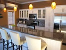 High end kitchen with Island bar - great for snacks, drinks, liming