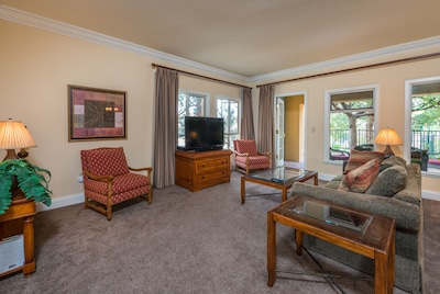 """Spacious living area with 50"""" HD TV"""