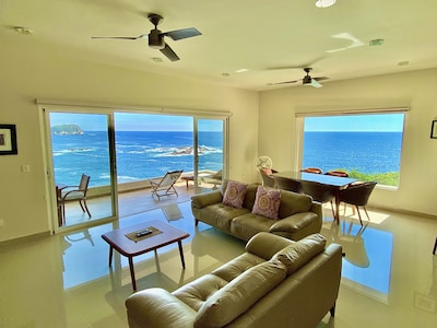 The condo sits atop a cliff with amazing, 180-degree views of the Pacific.