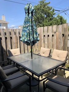 Outdoor patio set with enclosed fence for privacy
