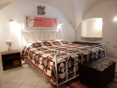 King sized bed in the vaulted sleeping alcove