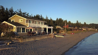 view of house from the sandy beach, gentle slope