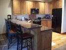 Gorgeous kitchen with granite countertops, gas range seating for 5 at counter