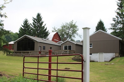 FARM HOUSE: view from the rear - entertainment area to left, hot tub in center