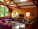 FARM HOUSE: large lower entertainment area with flatscreen, DVD and seating area