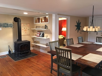 Kitchen / dining area with a wood burning stove