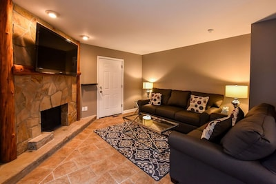 """Living room with """" television and gas fireplace"""