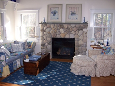 The Cottage Living Room with Beach Stone Fireplace