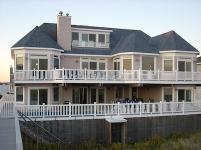 back of house, facing the ocean, with private beach walkway; Dune Rd / Bay beyon