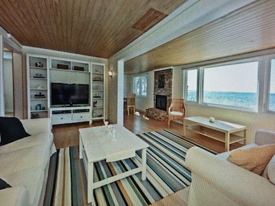Open living area with beautiful view of water