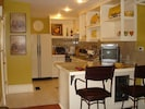 The cozy cottage kitchen is fully equipped for extended stays!