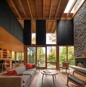 Be outdoors indoors: lake views + two-storey granite fireplace with skylight.