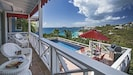 Veranda overlooking pool, deck, Caribbean sea.