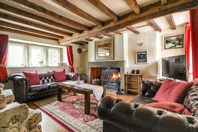Living room oozes charachter - stone lintel windows, inglenook fireplace & beams