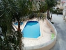 Swimming pool with sunbeds showers tables etc
