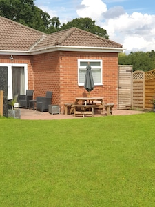 rear patio area  also use of large shared garden/lawn