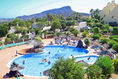 Apartment overlooks the main Los Olivos pool