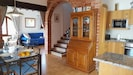 Open-plan kitchen / diner with lounge beyond