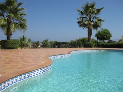 Lovely pool in landscaped gardens