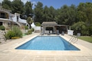 Large pool with garden kitchen & bar area