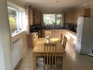 Kitchen with sea views to front and view of rear garden
