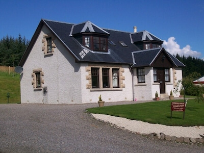 A Quiet but central wood-side  location at the Heart of  beautiful  Strathspey