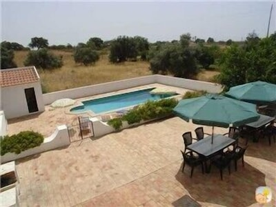 View of pool area from master bedroom balcony