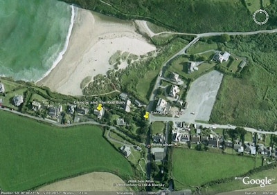 Shot from the air of Porthcothan and the position of the house on the beach