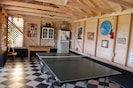 games room with table tennis, table football, darts, hoolahoops and fridge
