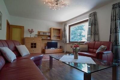 Lounge with custom made 14 seat leather sofa
