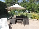 Shady lounge area on pool terrace