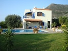 Side of villa and rear terrace via Bedroom 2