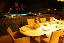 magical  dinners at night, facing the pool  !