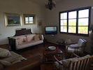 Sitting room with sea view and LCD TV