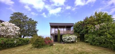 Stelzenbungalow mit Seeblick, Ferienhaus am Meer, Strandhaus