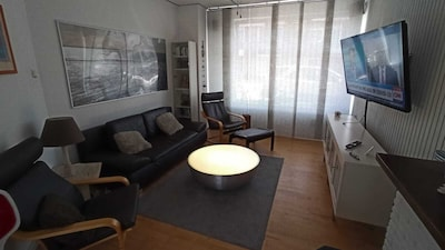 Livingroom with double glazing and ceiling fan
