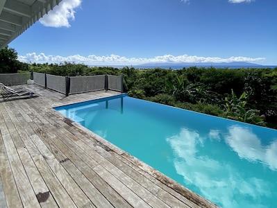 Grande villa vue imprenable sur la mer des caraïbes avec piscine à débordement