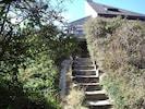 accès à la maison depuis l'endroit où l'on se gare