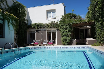 The poolside with garden furniture next to the pool