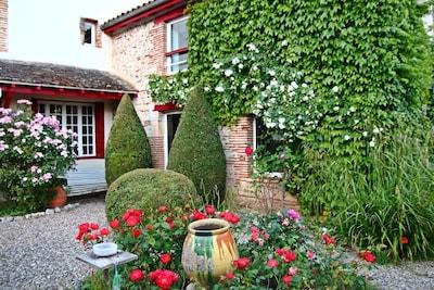 Terrasse-Jardin vue sur maison