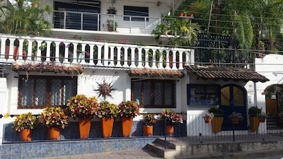 Front  view from street, white railing is Casa Luna patio