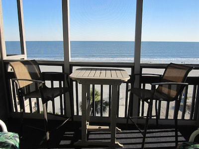 Oceanfront screened balcony located adjacent to living room.