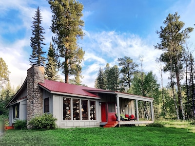 Exterior of cabin. No neighbors as far as the eye can see.