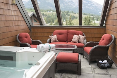Outdoor living space on private rooftop patio.