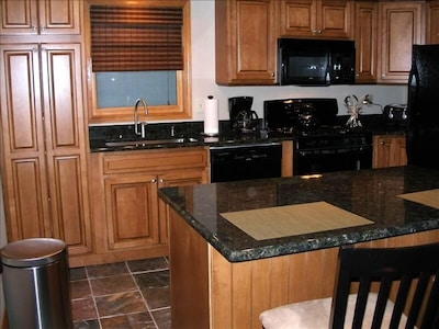 Granite countertops/ new cabinets/ slate floor/ all new appliances/ gas stove
