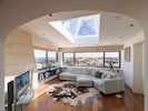 The topmost living room has a view that extends to Sicily on a clear day
