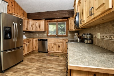 Enjoy a bit of luxury in the wilderness with the fully equipped modern kitchen.