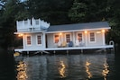 The boathouse at nighttime.
